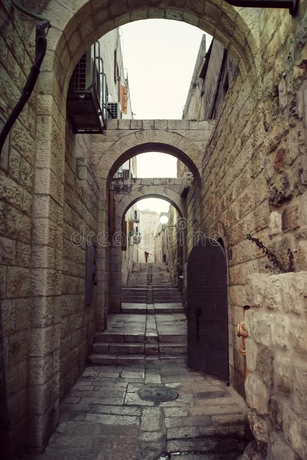 Mystical street at morning in the old city of Jerusalem. Old narrow streets in the quarter of Jerusalem.  royalty free stock photo