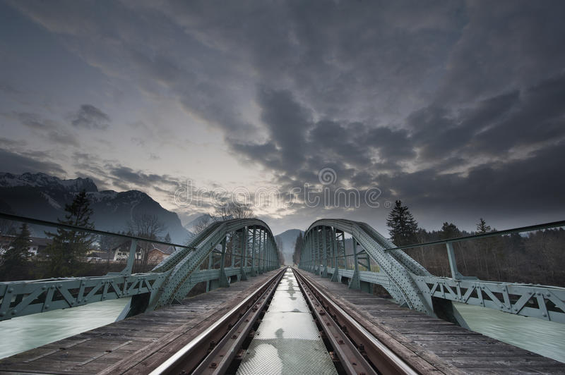Mystical train bridge made of steel and dramatic s royalty free stock image
