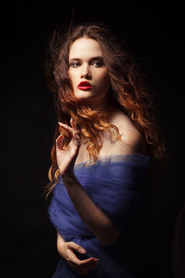 Mystical woman, studio shot. Beautiful and elegant model in dress stock photo