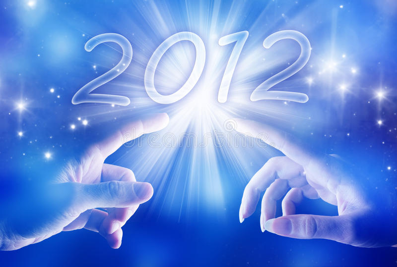 Mystical year 2012. Hands of a man and a woman approching light and new year 2012 royalty free stock images