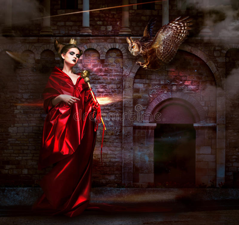 Mysticism. Witchcraft. Sorcerer in Red Mantle with Vulture - Hawk. Ancient Scary Castle. Woman with Vulture - Hawk. Ancient Scary Castle stock image