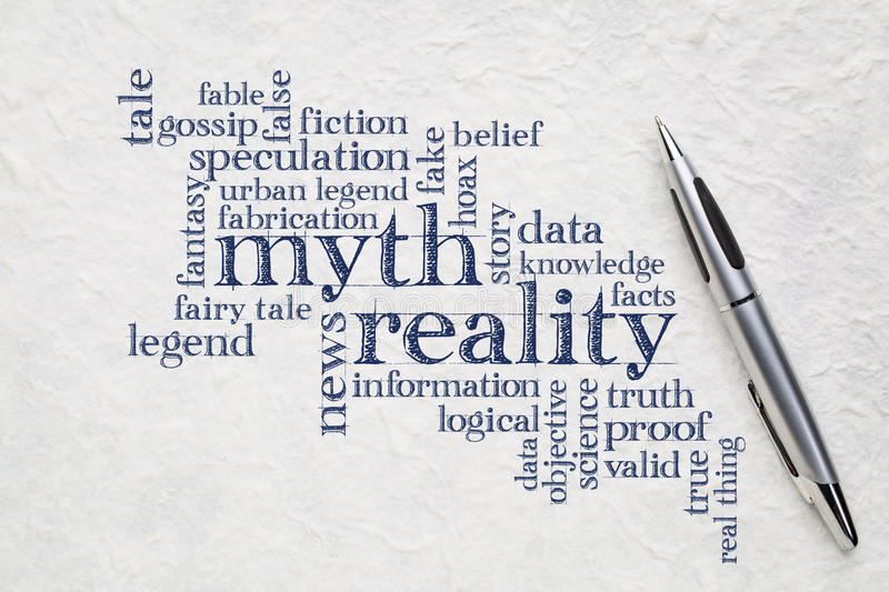 Myth and reality word cloud. Myth versus reality word cloud - handwriting on a lokta paper with a pen stock photography