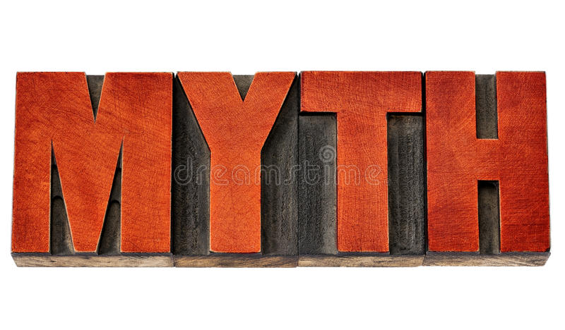 Myth word in letterpress wood type. Myth - isolated words in vintage letterpress wood type stained by red ink stock photography
