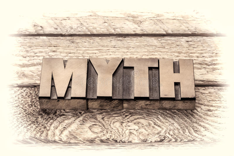 Myth word in vintage letterpress wood type. Sepia toning stock photo
