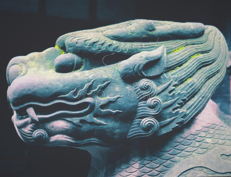 Mythical Animal stone sculpture head. As an ancient guardian in Chengdu Wuhou Shrine, Sichuan province, China royalty free stock image