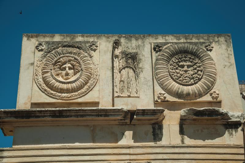 Mythological face carved in marble block at the Roman Forum in Merida stock photo