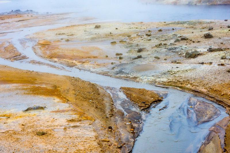 Myvatn geothermal area. Smoke from the ground stock photography