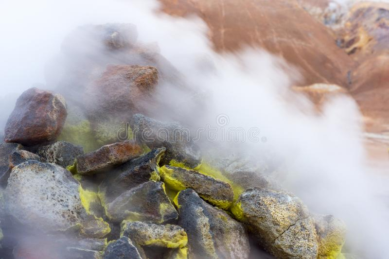 Myvatn geothermal area. Smoke from the pile of rocks royalty free stock photos