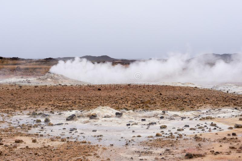 Myvatn geothermal area. Smoke from the pile of rocks stock photo