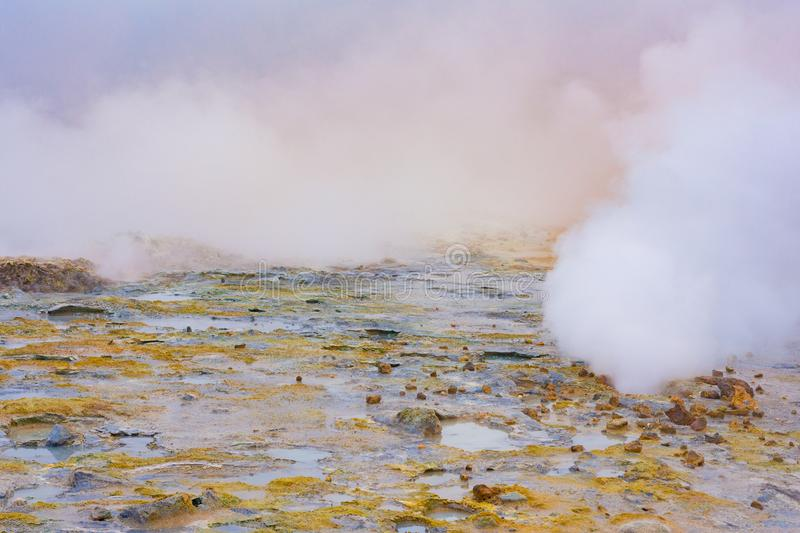 Myvatn geothermal area. Smoke from the ground stock images