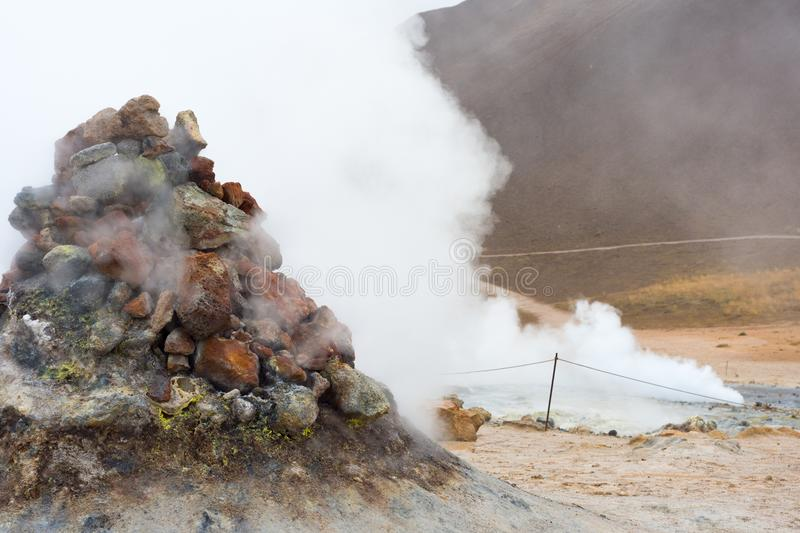 Myvatn geothermal area. Smoke from the pile of rocks royalty free stock images