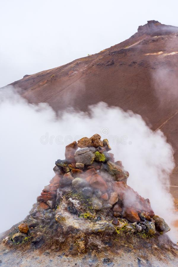 Myvatn geothermal area. Smoke from the pile of rocks royalty free stock photo