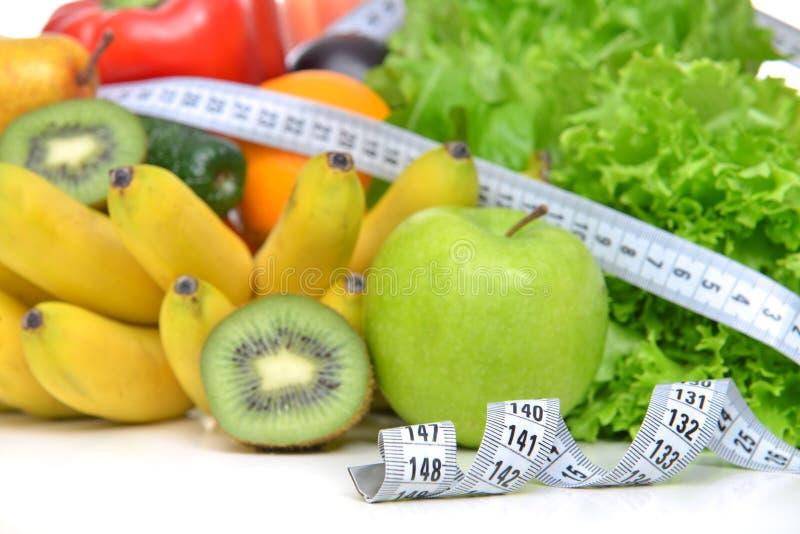Nähren Sie Gewichtsverlustfrühstückskonzept mit Maßband organisches gre lizenzfreie stockfotos