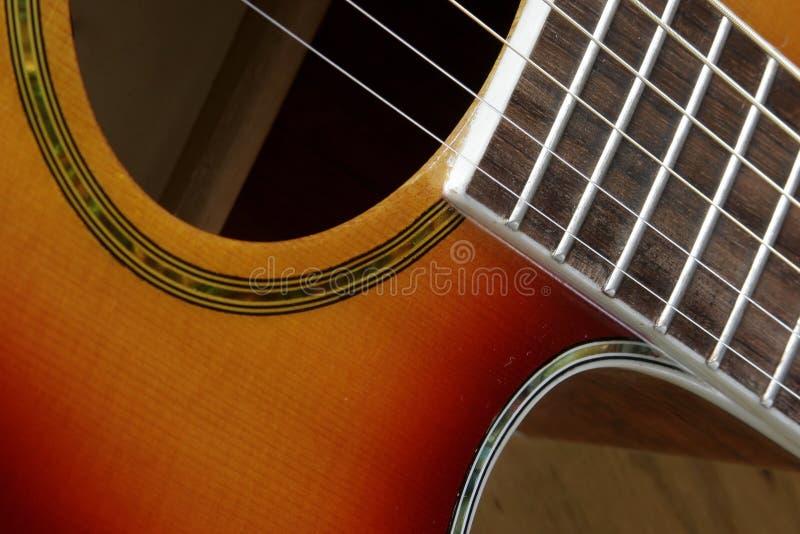 Nära övre för gitarr arkivfoto
