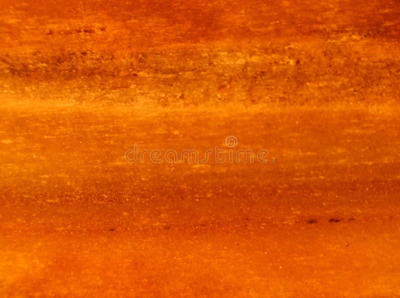 Nära övre sedimentär sten för makro i solljus Röd orange bakgrund arkivbild