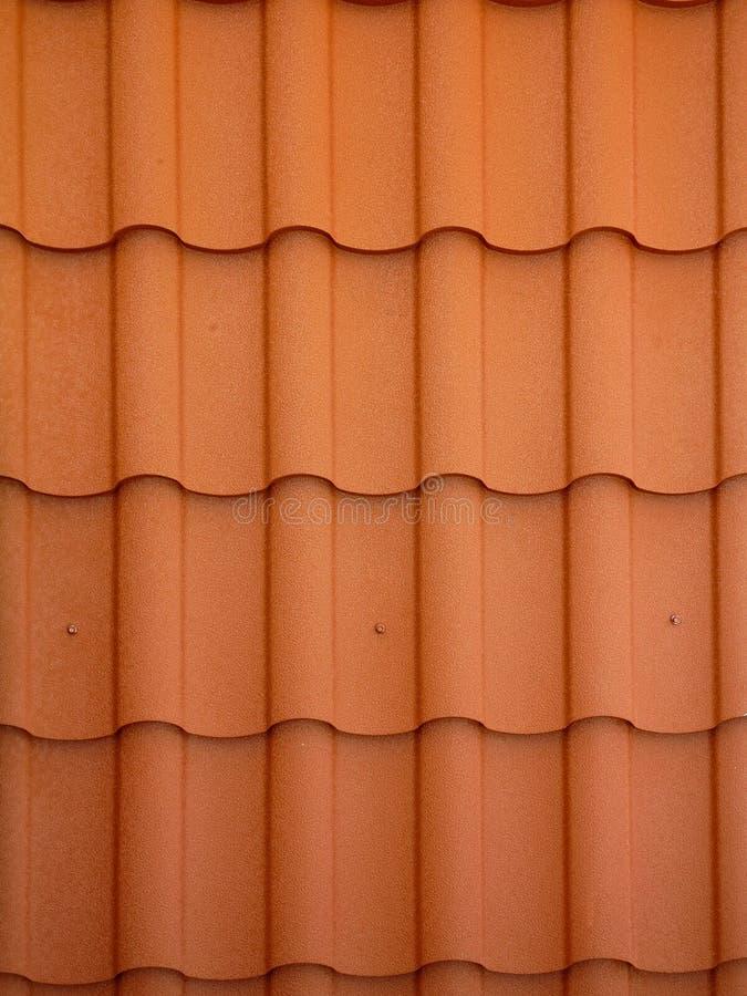 Nära övre sikt på röd spansk lerategelpannabakgrund royaltyfri fotografi