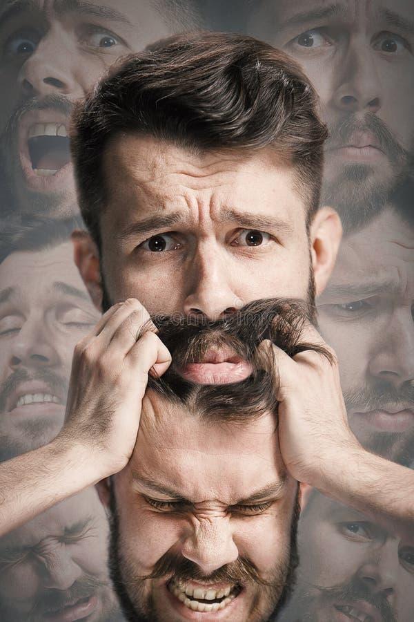 Nära övre skott av ledsen och ilsken sinnesrörelse på framsida av den missmodiga mannen arkivfoto