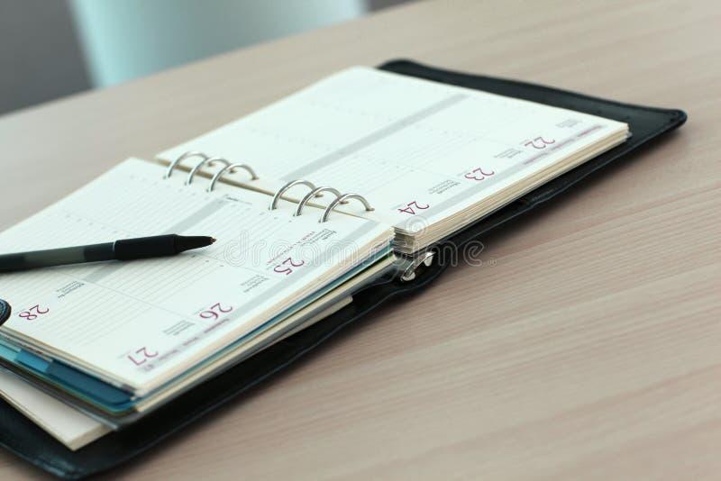 Närbild av affärsdagordningen royaltyfri foto