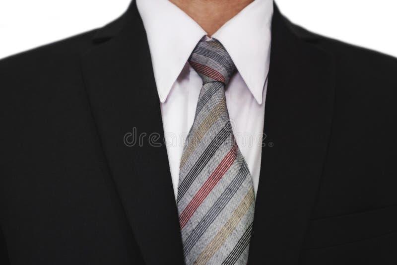 Närbild av affärsmannen som bär den svarta dräkten med ett grått band, vit skjorta royaltyfria bilder