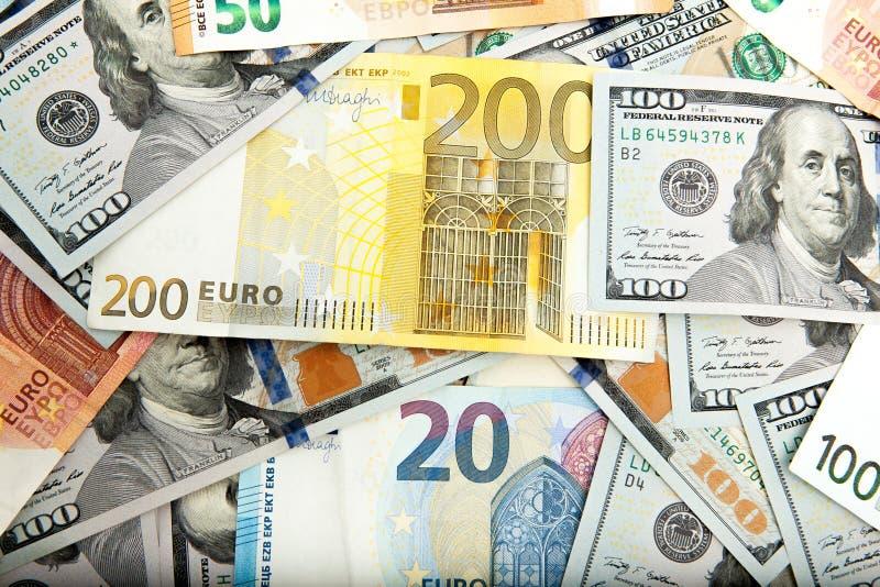 Närbild av amerikanska US dollar och euro fotografering för bildbyråer