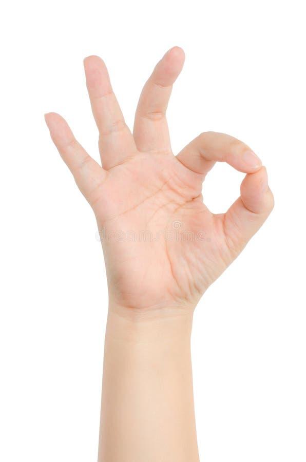 Närbild av den kvinnliga handen som gör en gest, medan isolerat på vit arkivbild