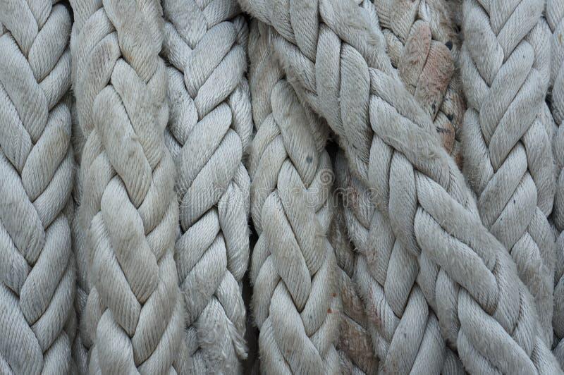 Närbild av det gamla repet, textur för fartygrep arkivbilder