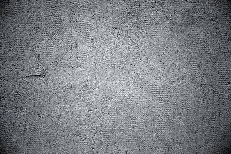 Närbild av en grå gammal vägg arkivbilder