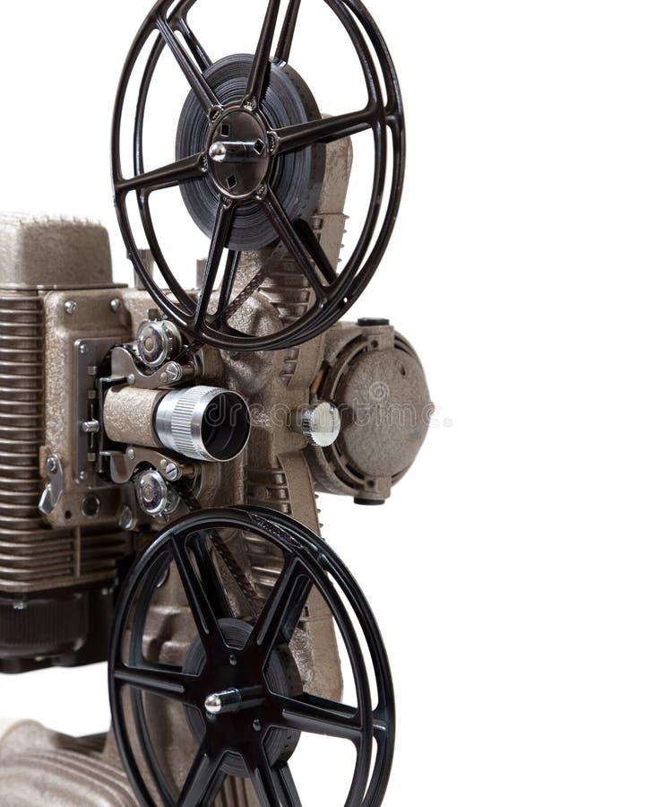 Närbild av en tappningfilmprojektor på en vitbakgrund arkivbild