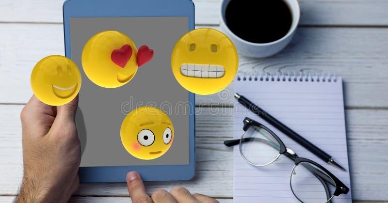 Närbild av händer genom att använda minnestavlaPC medan emojis som flyger över tabellen royaltyfri illustrationer