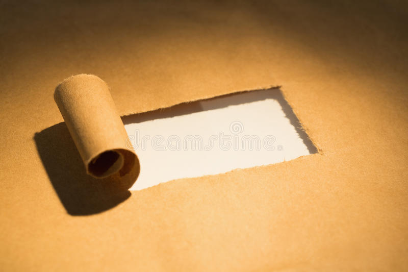 Närbild av sönderrivet papper royaltyfri bild