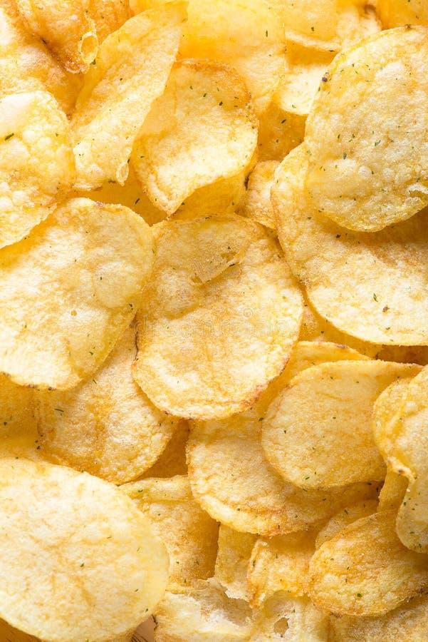 Närbild för bakgrund för potatischiper royaltyfria bilder