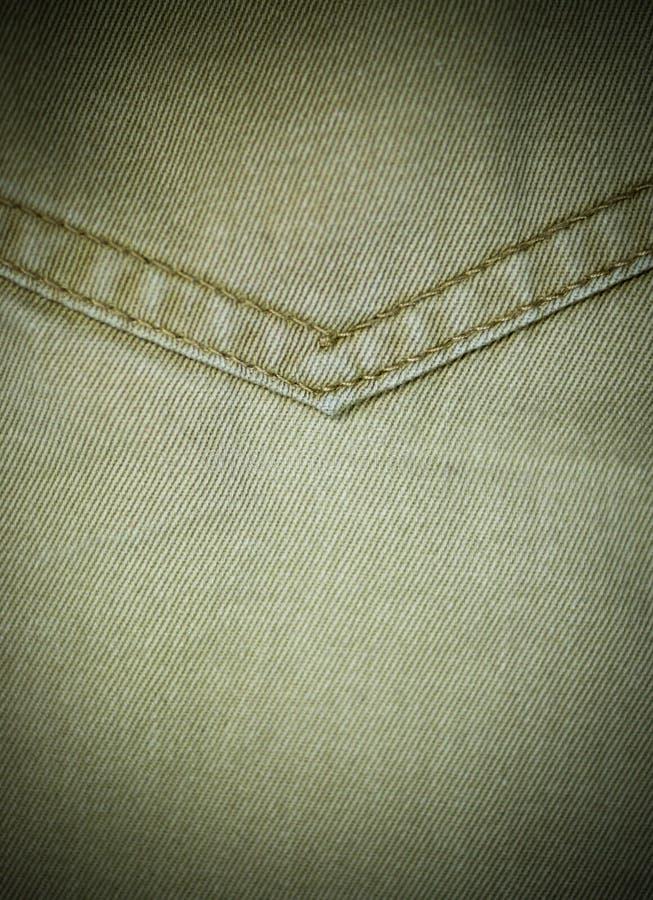 närbild för textur för jeansgrov bomullstvillfack detaljerad med karaktärsteckning Bakgrund tyg royaltyfria bilder