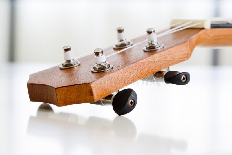 Närbilddel av ukulelegitarren arkivfoton