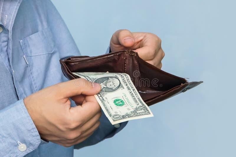 Närbildhandväska med dollar i deras handaffärsman royaltyfri bild
