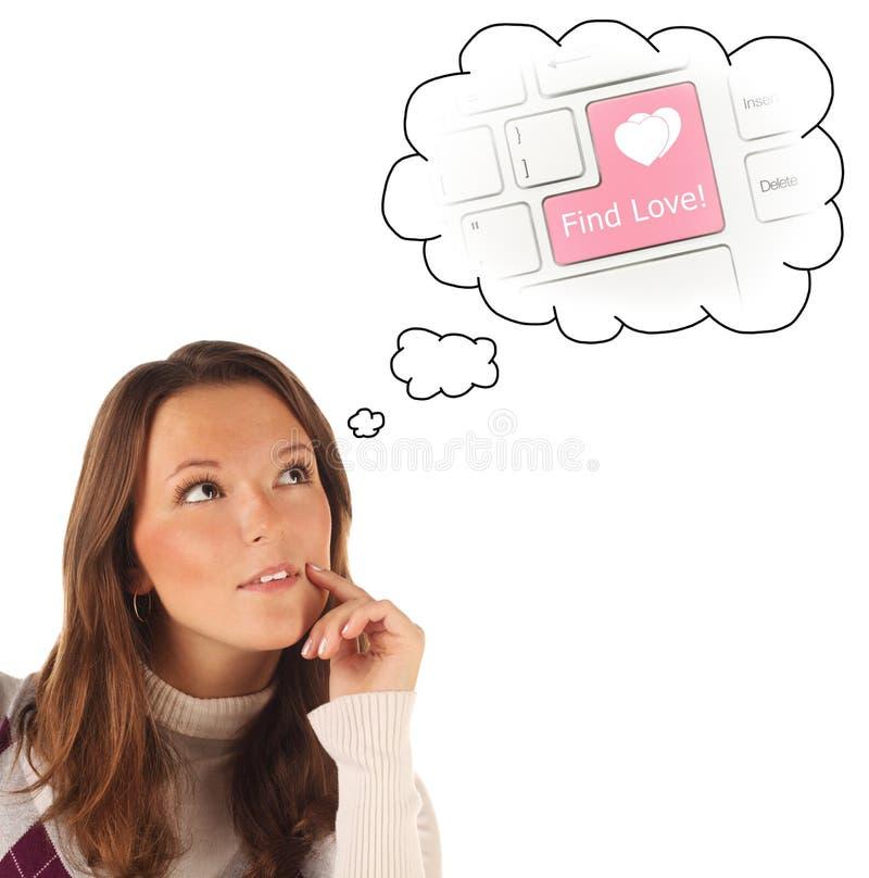 Närbildstående av flickan som drömmer om internetdatummärkningen (isolat arkivfoto