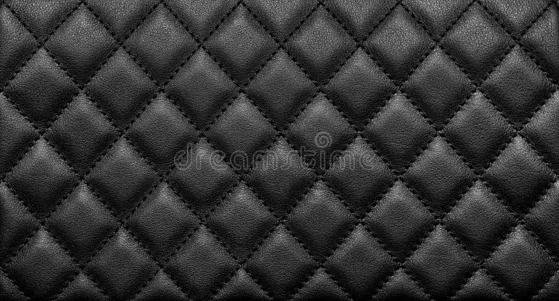 Närbildtextur av äktt läder med svart rhombic sy royaltyfri foto