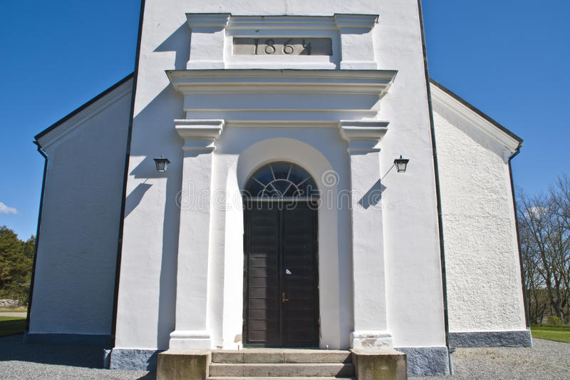 Näsinge church (entrance). Näsinge church was built in 1864 in tomorrow's traditional style, whitewashed, seafaring and with spacious interior. The former stock images