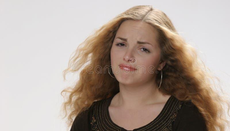 nätt besviken flicka arkivfoto