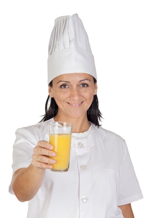 nätt för glass fruktsaft för kockflicka orange arkivfoton