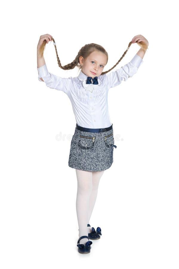 Nätt flicka med råttsvansar arkivfoton