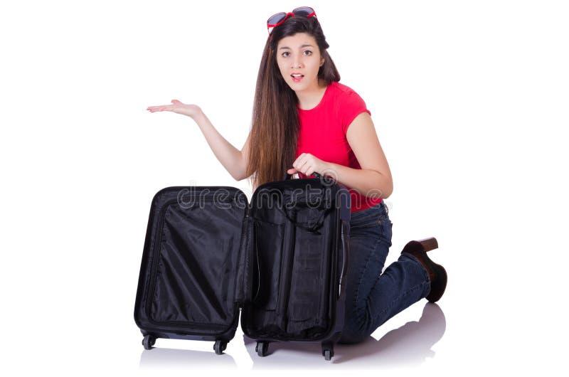 Nätt flicka med resväskan som isoleras på vit arkivfoton