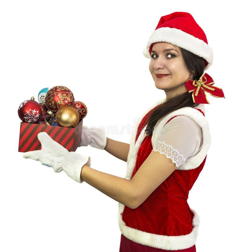 Nätt jultomtenflicka med dekorativa struntsaker arkivfoto