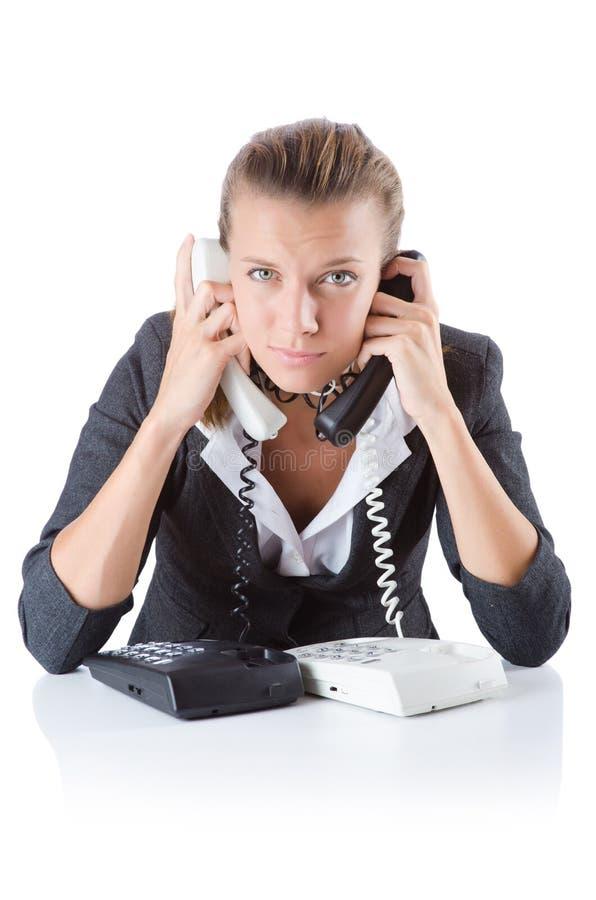 Nätt kontorschef som talar på telefonen arkivbild