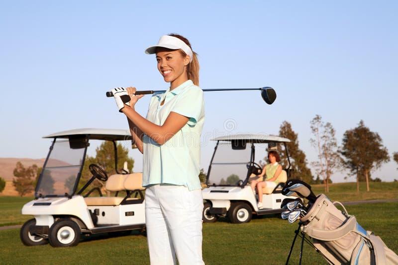 nätt kvinna för golfare royaltyfri fotografi