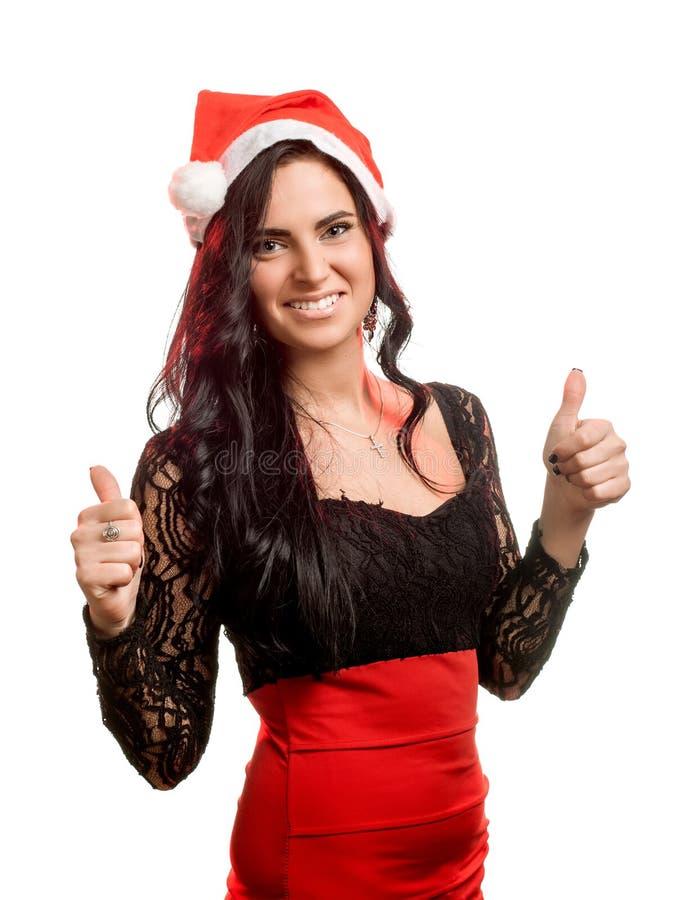 Nätt kvinna i den röda Santa Claus hatten arkivbild