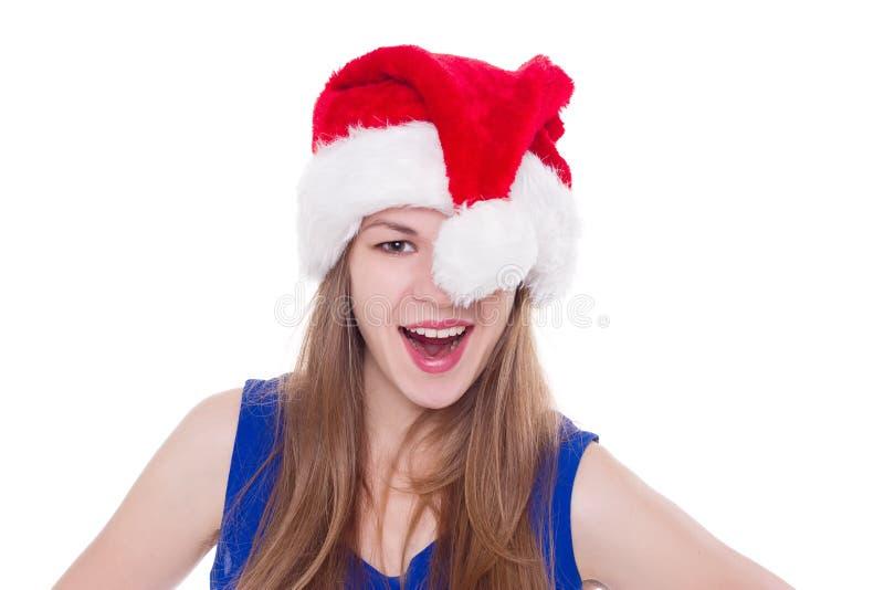Nätt kvinna i den röda Santa Claus hatten royaltyfri foto