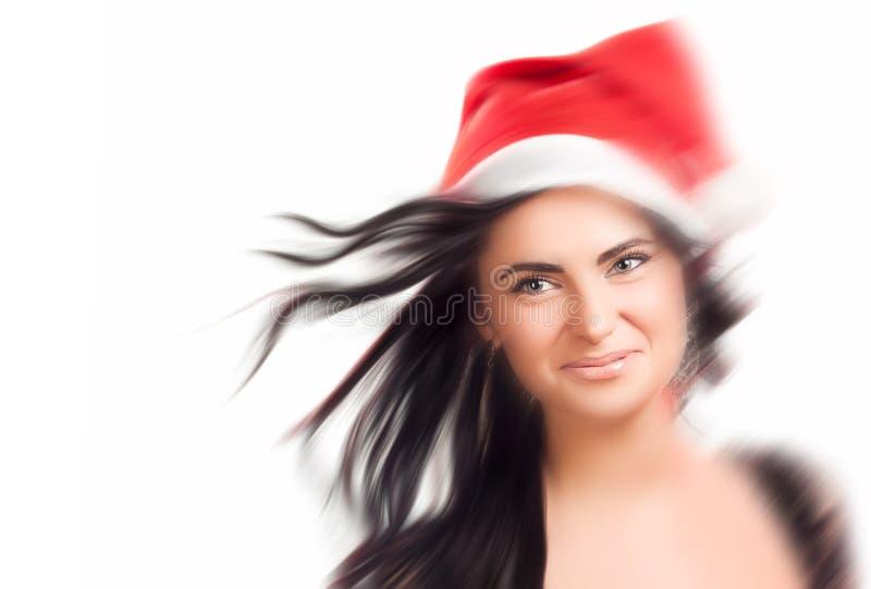 Nätt kvinna i den röda Santa Claus hatten royaltyfria foton