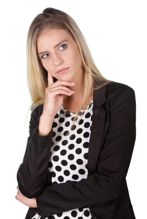 Nätt kvinna i djup tanke arkivfoto