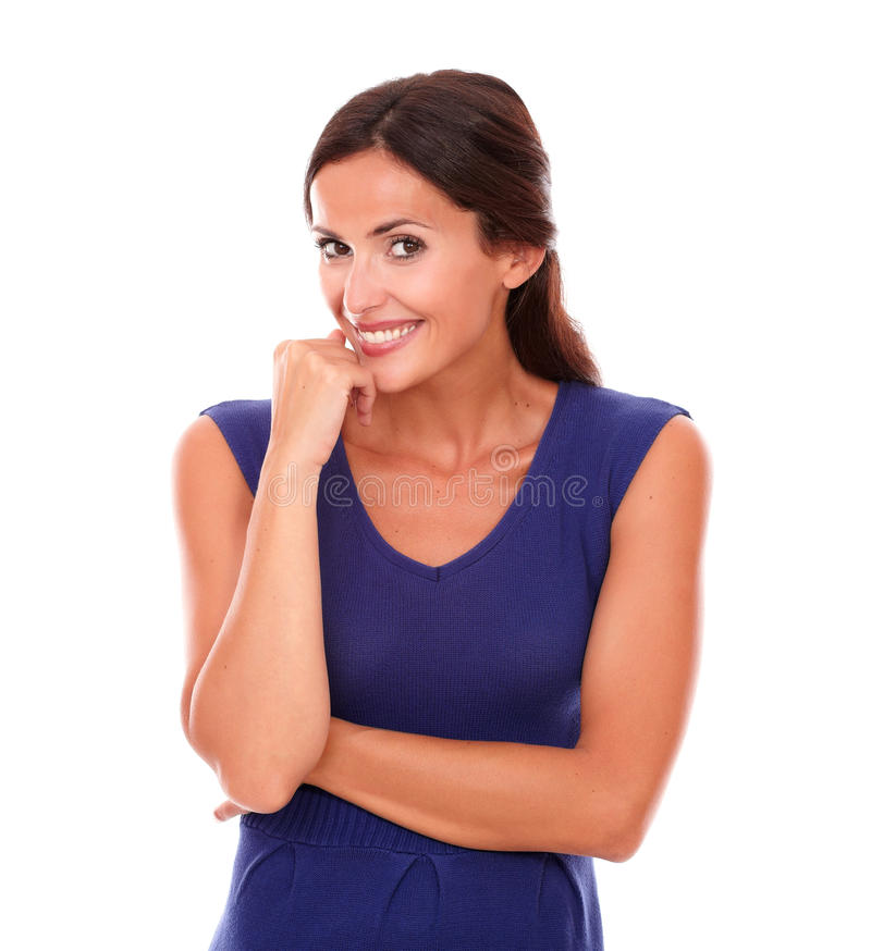 Nätt kvinna som ler och ser blyg royaltyfria foton