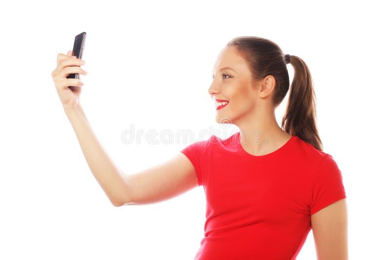 Nätt kvinna som tar selfies arkivbild